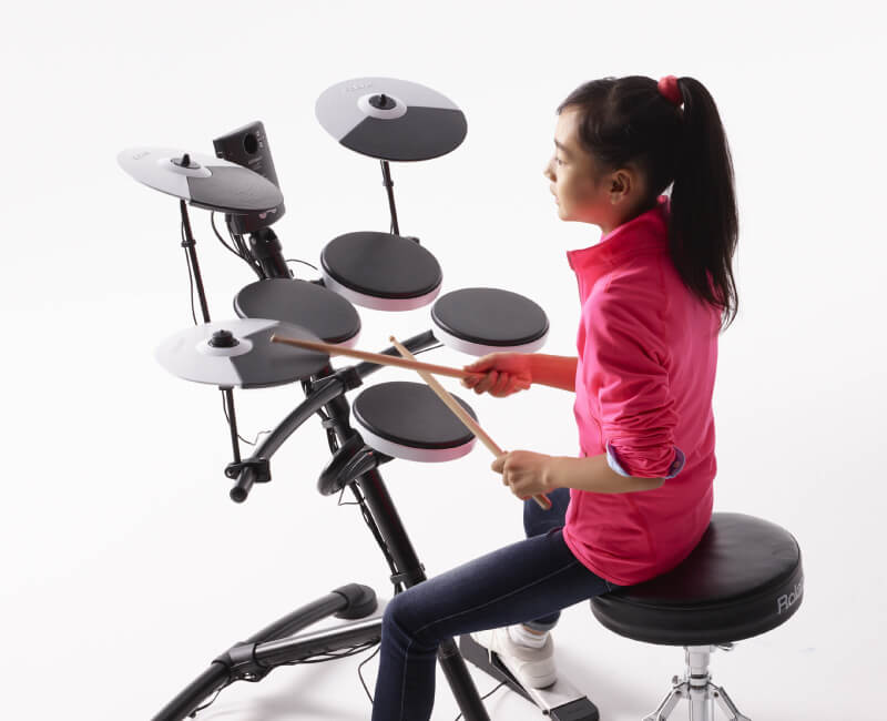 Girl playing drums in Katy
